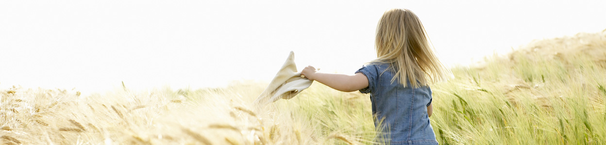Girl running in a wheat field --- Image by © Ghislain & Marie David de Lossy/cultura/Corbis